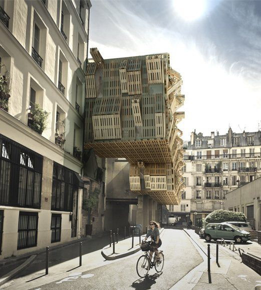 Reusing wooden panels to create a new facade on an old building. Paris, France