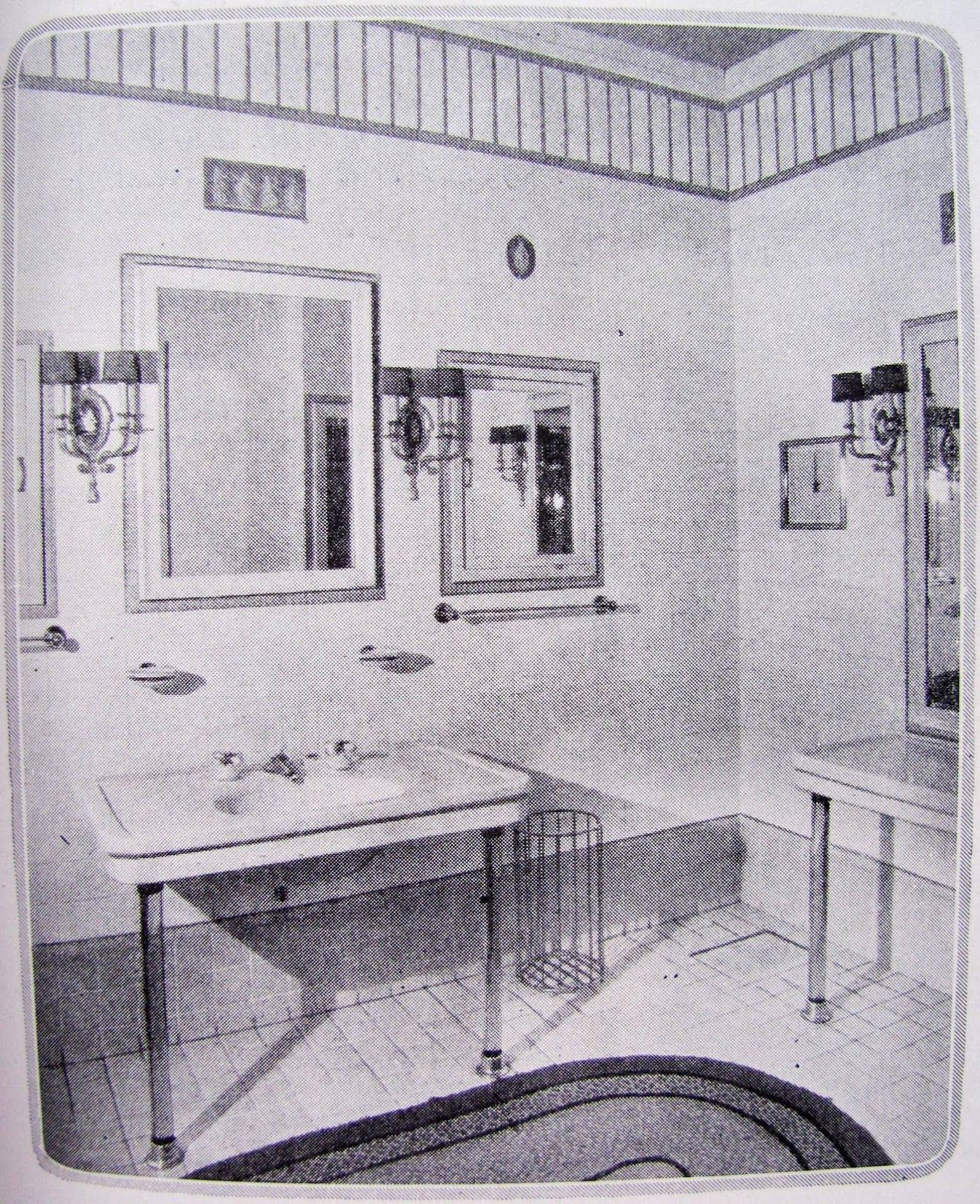 The Sink With Twin Mirrors Flanking The Vanity Mirror Has