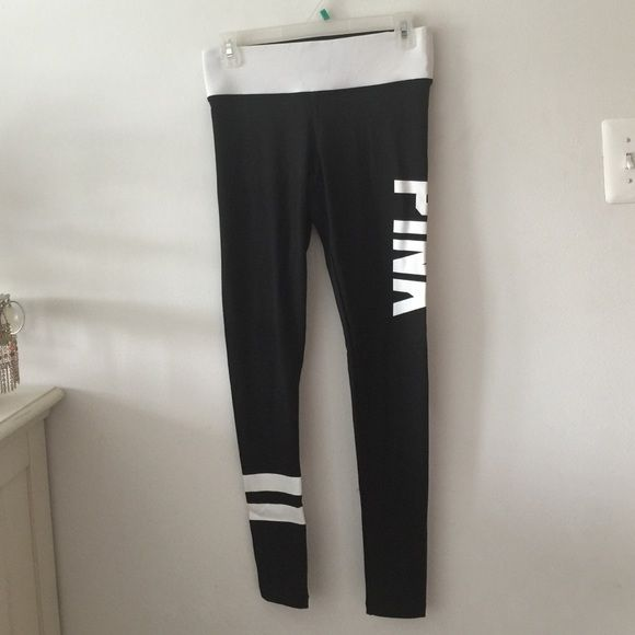 Pink yoga pant leggings Size xs. From Victoria's Secret pink collection. Black leggings with a white waistband and white writing on the right leg and two stripes on the bottom left leg. Worn once in brand new condition Victoria's Secret Pants Leggings