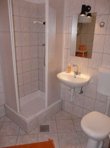 tile makes walls recede, very small shower, sink, and