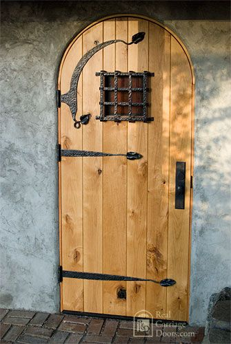 Arched Plank Door With Decorative Hardware Made Of Rustic