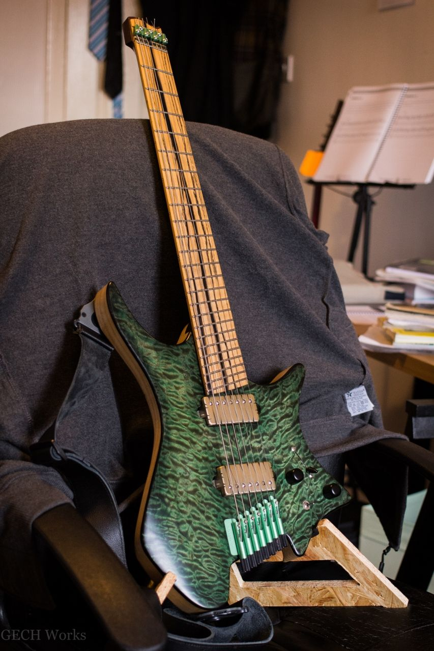 "strandberg* #51  Swamp Ash Body  Green Flamed Maple Top  Rosewood ""Endurneck"" profile neck with Walnut laminates  Pale Moon Ebony Fretboard with stainless steel frets  25.75"" to 27"" fan  Green Luminlays side dots  Mint green .strandberg* hardware  Bareknuckle Nailbomb Ceramic bridge with Tyger cover  Bareknuckle VHII Alcino V neck with Tyger cover  5-Way Blade (Neck, Neck tapped, Both, Bridge tapped, Bridge)"