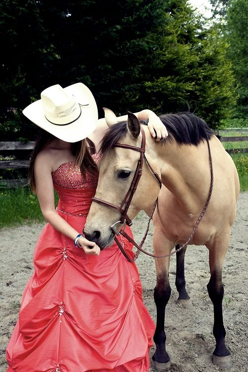 woahh totally doing this if i ever feel like going to prom ... But if she's trying to be a cowgirl , which is western then why does the horse have an English bridle on?
