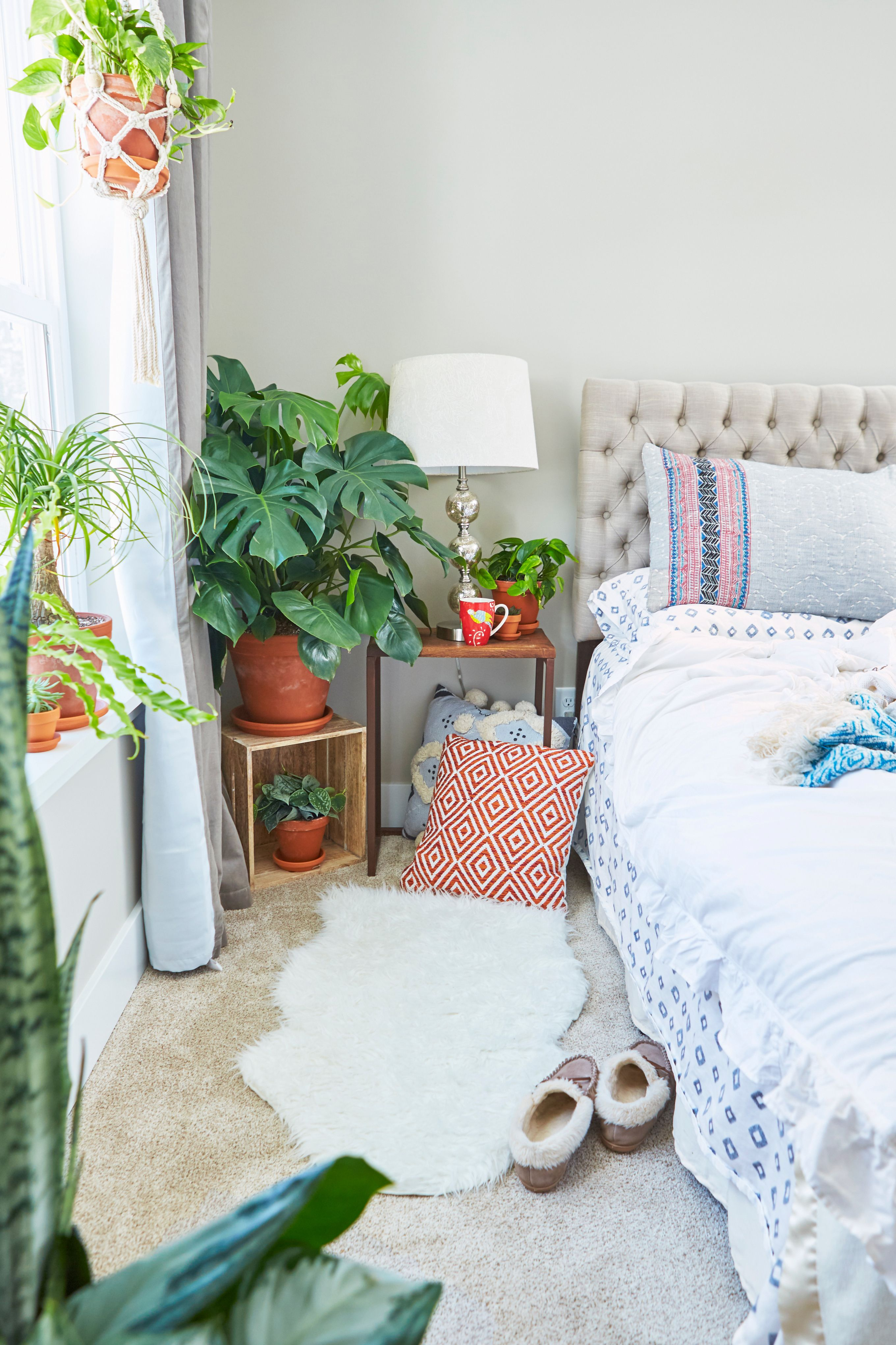 Plants make a big difference in a neutral bedroom. Place a