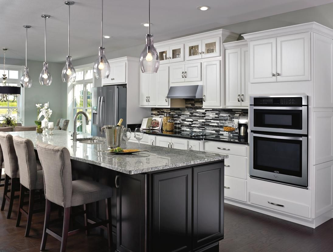 Sleek And Refined Aristokraft S Landen Cabinets Have A Beautiful Modern Look In This Wel In 2020 White Kitchen Remodeling Lake House Kitchen Black Kitchen Countertops