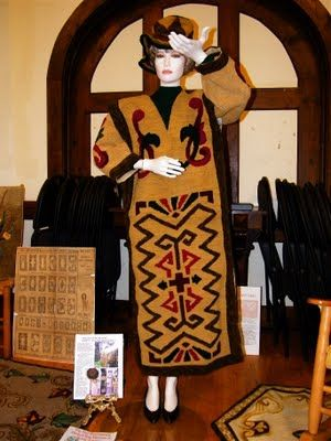A hooked dress was on display. It was created from a snapshot photo of an early 1900's John E. Garrett factory brochure. The patterns on the dress are some of the original 550 pen and ink drawings recovered by Hooked Rug Museum of North America researchers.