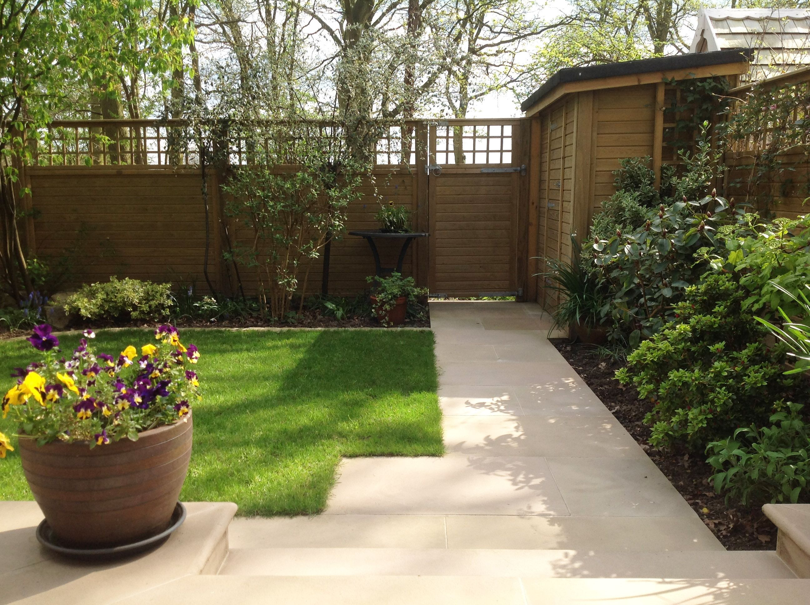 Fencing and Trellis Help Create a High-End Surrey Garden ... on Square Patio Designs  id=77691