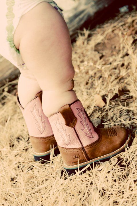 My neice Rhylee...her legs were almost too chubby for those john deere boots! (BEST photographer - Kim Durham at KD Photography, Gravette, AR)