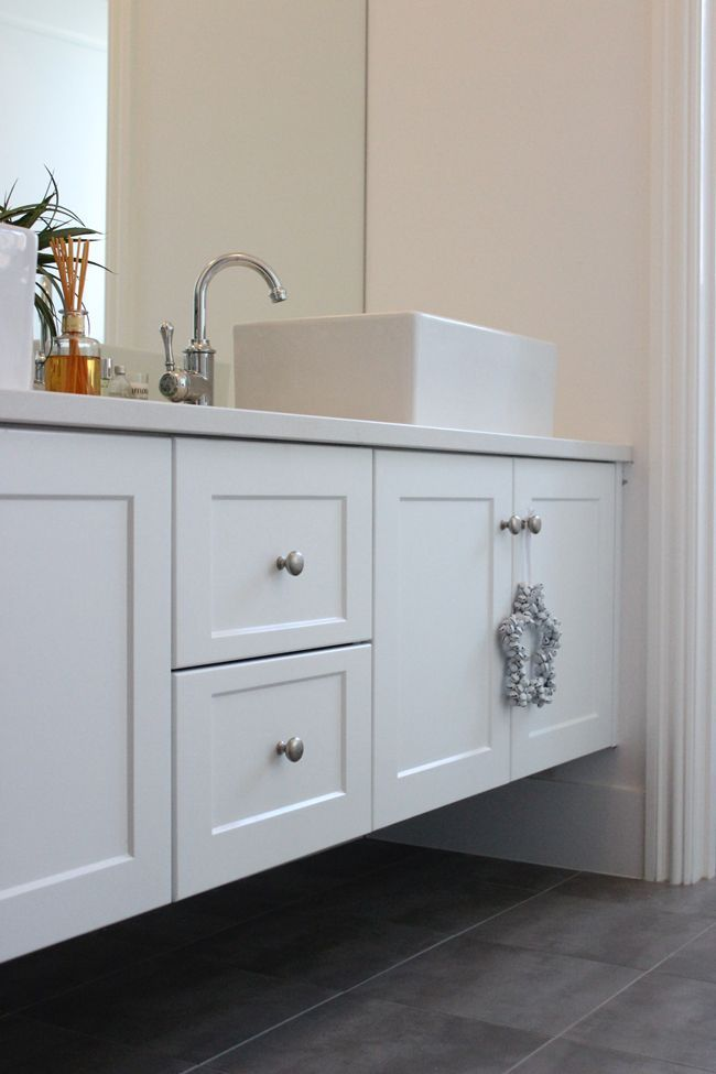 Vanity Outside Bathroom outside of the raised sink, nice look with white vanity and dark