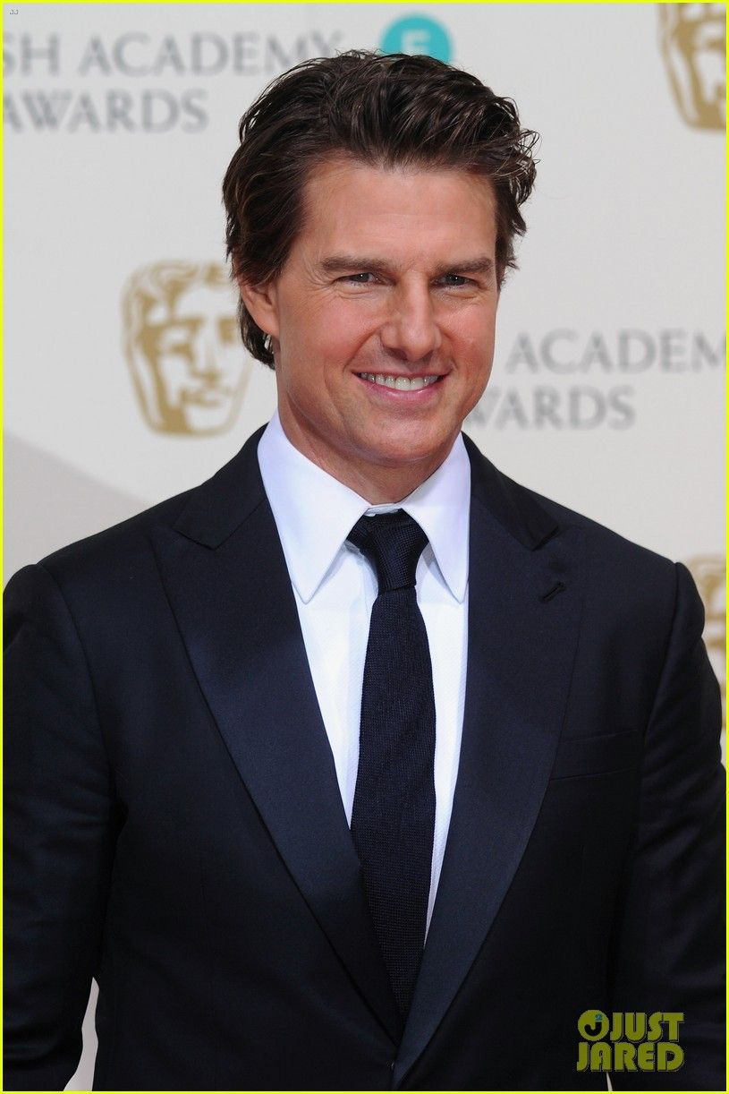 Tom Cruise suits up and looks so handsome while walking the red carpet in the press room at the 2015 EE British Academy Film Awards held at The Royal Opera House on Sunday (February 8) in London, England.