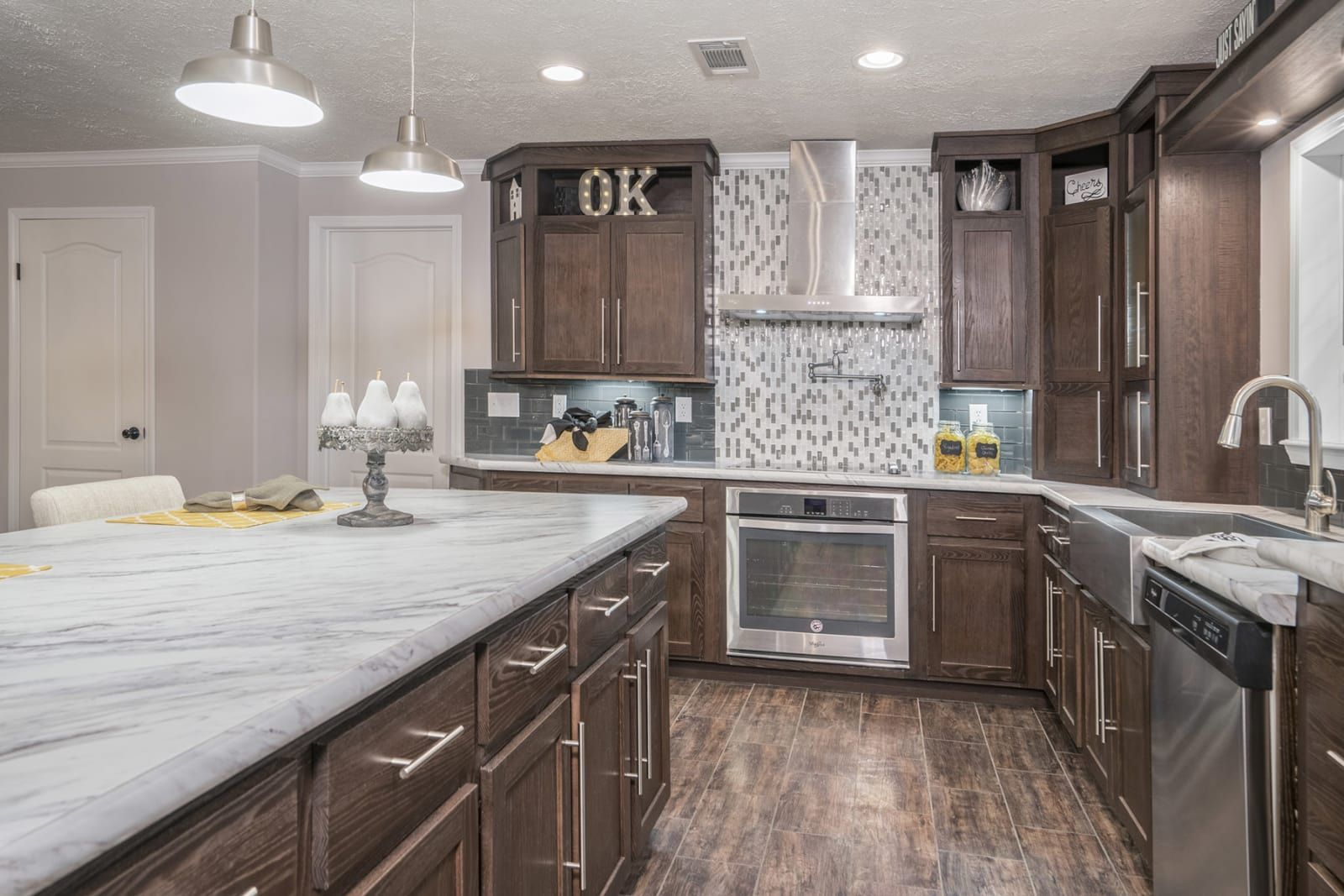 Kitchen with dark wood floors, stainless steel