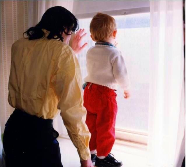 Michael Jackson and Prince Jackson looking through the window.