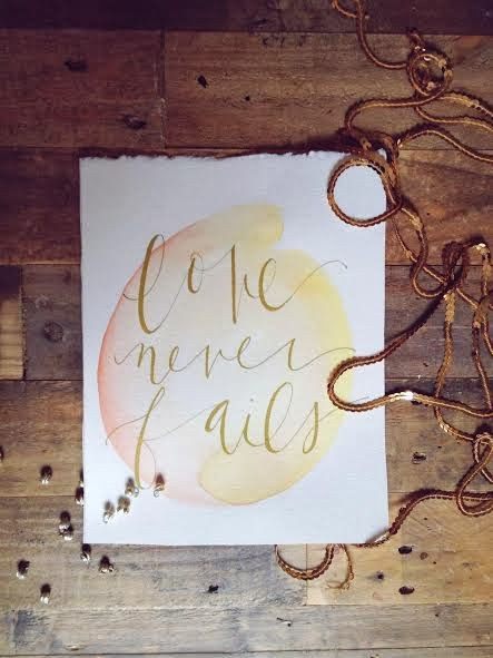 Love never fails modern calligraphy boho baby bump ink