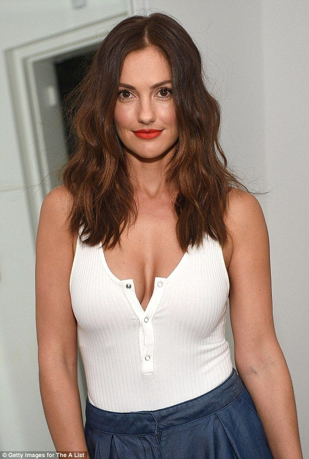 Minka Kelly shows off plenty of cleavage in low-cut white ...
