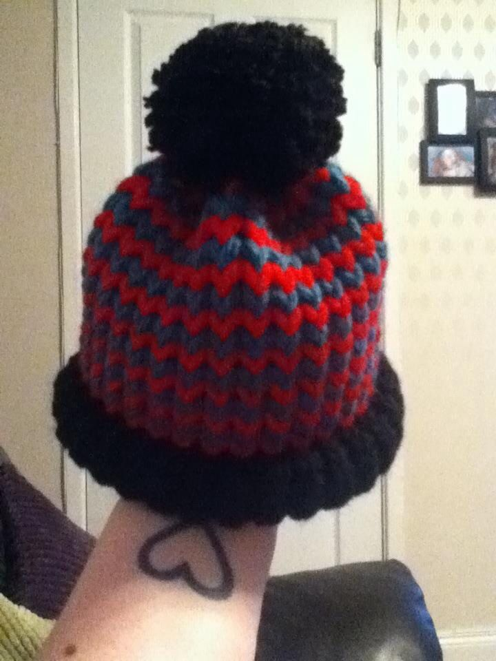 a57242b86aa35 Loom knit hat - Red and green stripes with black brim and pom pom ...