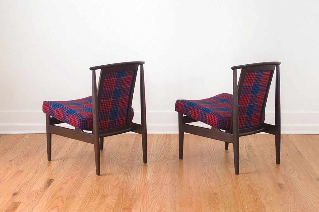 """This handsome set of restored Mid Century wood lounge chairs were made by Dux. They're upholstered in a black, red, blue and yellow vintage tartan plaid wool fabric that was made in England. They have a floating seat with new foam, dark wood frames and a curved backrest which makes them very comfortable. These chairs are sturdy and in excellent condition.  25"""" Deep x 22"""" Wide x 30"""" Tall x 19.5"""" Seat Depth"""