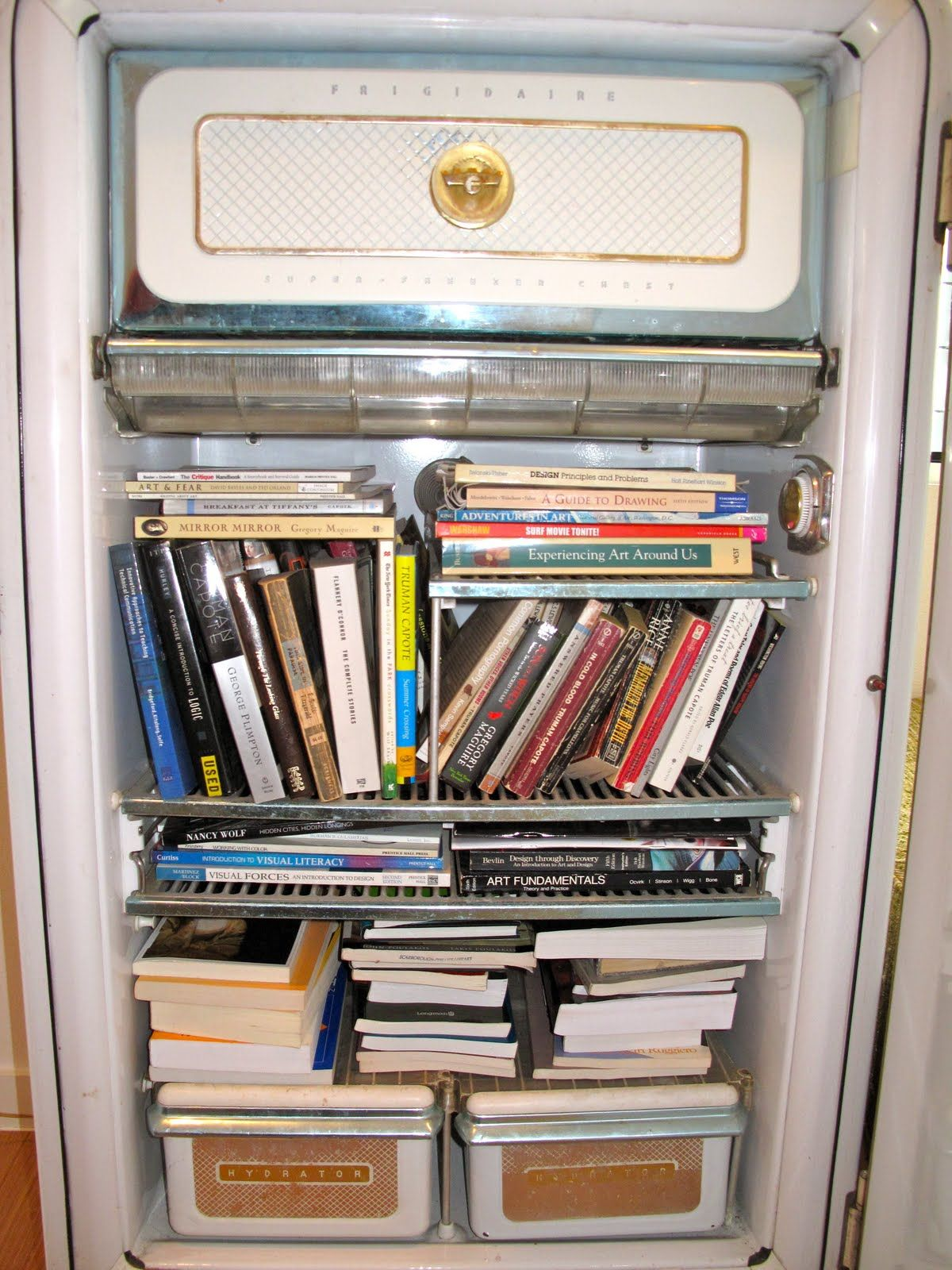 """I love this- get an old refrigerator and turn it into something different, like a bookshelf!   """"I'd like a nice, cold book..."""""""