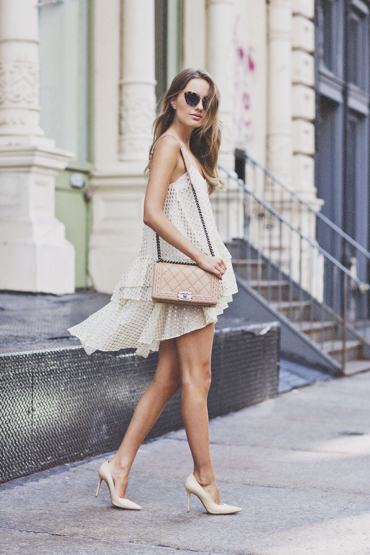 Sonya Esman is wearing a cami dress from Front Row, shoes from Celine, bag from Chanel and the sunglasses are from Miu Miu