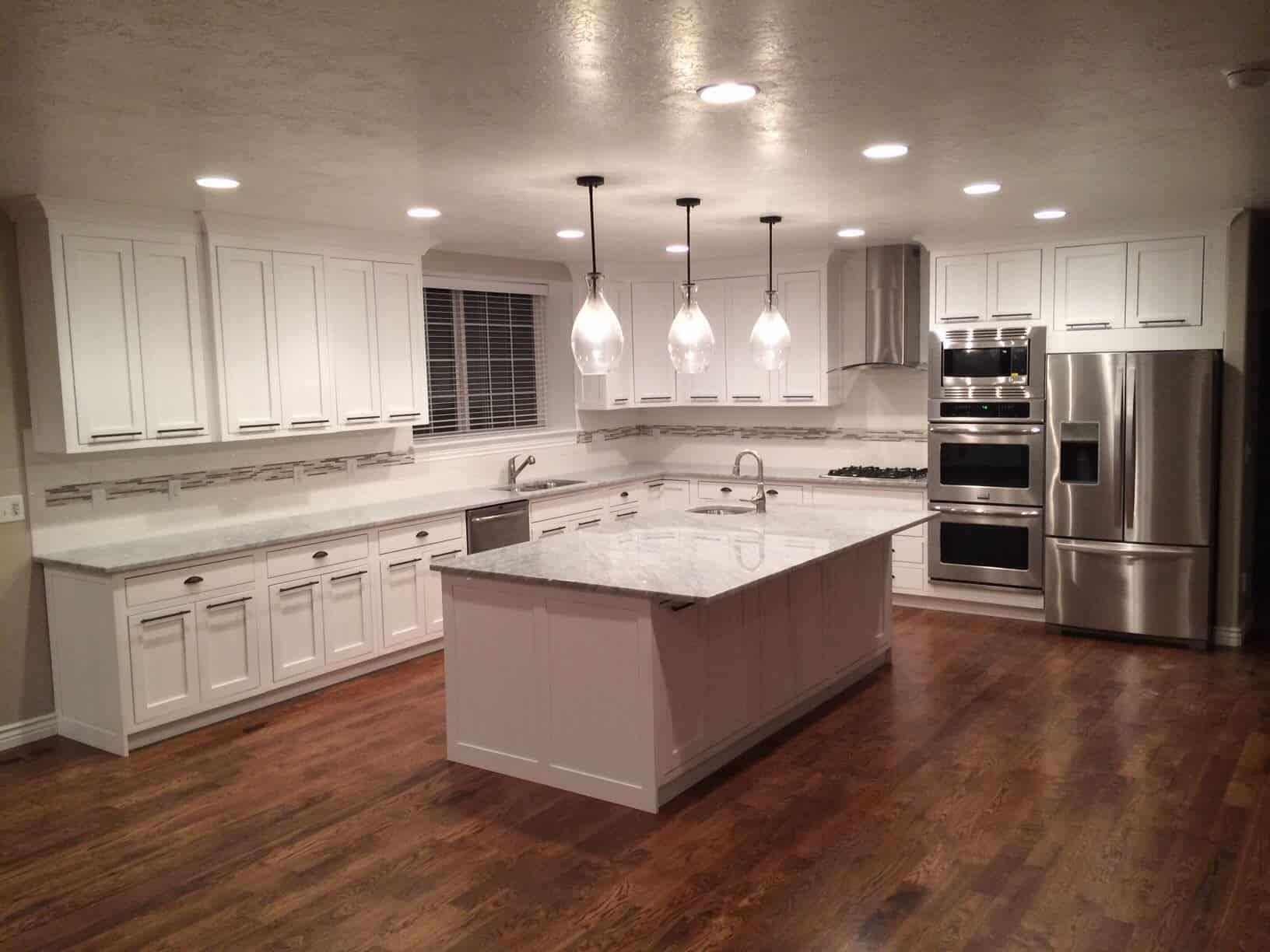 Medium tone hardwood floor in kitchen   Kitchen flooring options ...