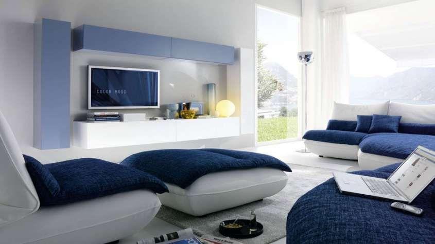 Idee per arredare il soggiorno soggiorno in bianco e blu for Mobili per soggiorno