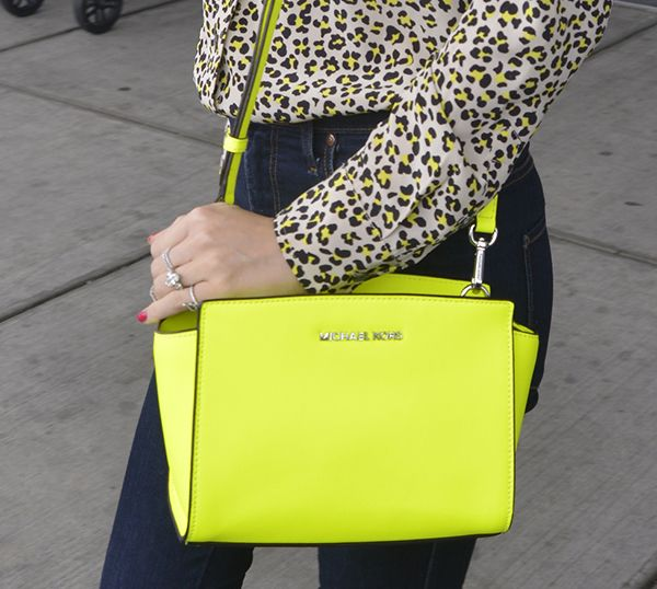 Miranda Kerr carrying a neon yellow Michael Kors 'Selma