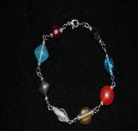 This beautiful 6.5 inch peace is accented in multipul colors ranging from red to blue and it doesn't stop there. This peace is linked together with silver toned wire links.  $15.00