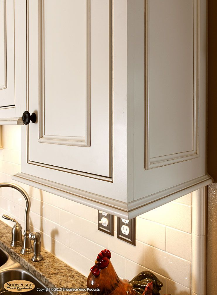 Showplace Cabinets In Soft Cream With Carmel Glazing