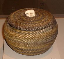 nupiat basket, with an ivory handle, made by Kinguktuk (1871–1941) of Barrow, Alaska. Displayed at the Museum of Man, San Diego, California.
