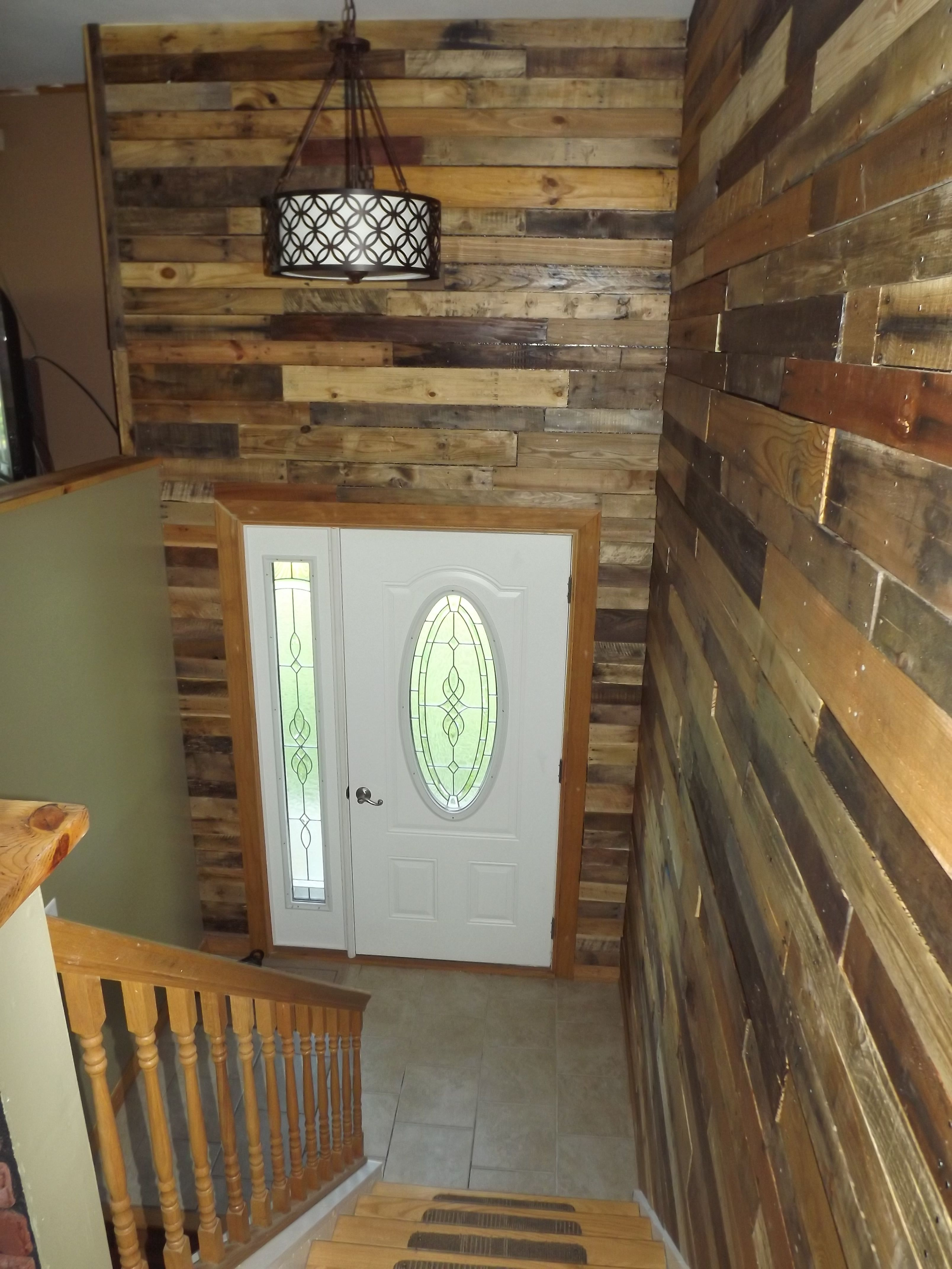 my bi level home foyer with pallet wood walls for the