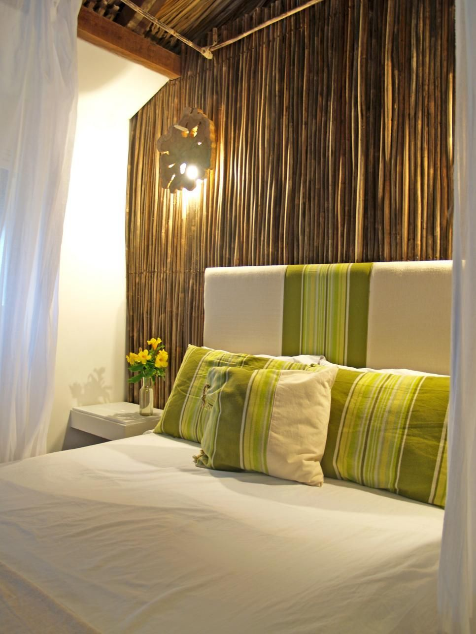A large bed with coordinating throw pillows and headboard is