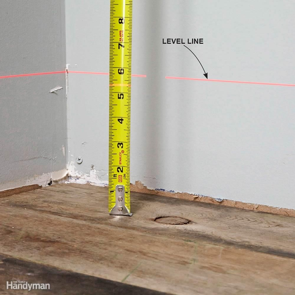How To Use A Laser Level Laser Levels Remodeling Tools Installing Cabinets
