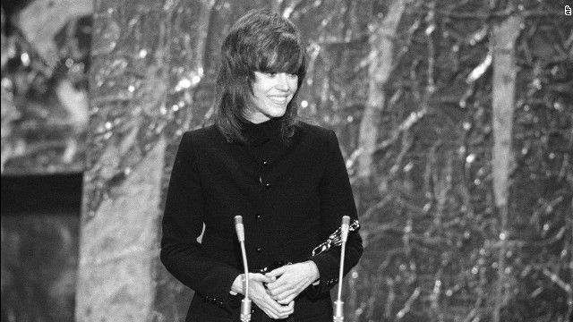 """Jane Fonda cradles the best actress Oscar she received for """"Klute."""""""