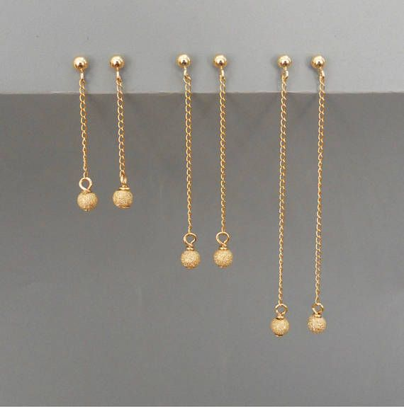 Dainty Gold Stardust Dangling Earrings Gold Dangling Earrings With Stardust Bead Long Gold Stu Gold Earrings Designs Gold Chain Earrings Gold Jewelry Outfits