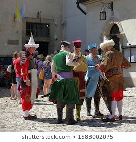 Krakow / Poland - June 27 2019: Traditional Lajkonik (Polish name of legendary creature) Festival, men in historical costumes, in air lots of small pieces of gunpowdre after shot #annual, #clothes, #colorful, #costumes, #cultural, #culture, #ethnic, #event, #festival, #gunpowder, #historical, #holiday, #in air, #legend, #legendary, #men, #outdoors, #people, #pieces, #shot, #stand, #street, #tourism, #tradition, #traditional, #unique, #view