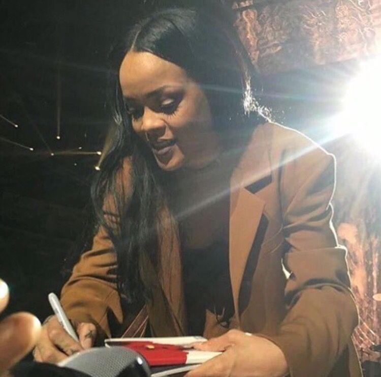 April 3 Rihanna signing a fan's Anti album at ANTI World