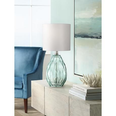 Illuminate your home with this set of two light blue glass table lamps with an elegant