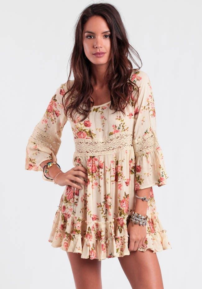 91c1a09dc7e Cream tunic dress featuring a floral print in hues of pink
