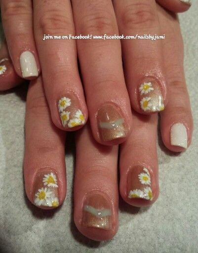Shellac flower nail art. Follow me on my nail page at www.facebook.com/nailsbyjami #nailart #naildesigns #cutenails #nailartjunkie #nailpro #flowernailart #nailsmagazine #nailpromagazine #handpainted #uniquenails #uniquenailart #cndshellac #nailprodigy #rockstarnails #nudenails