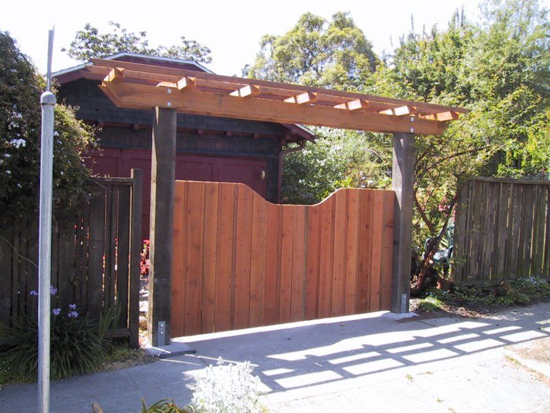 We would like something like an arbor over the driveway for Garage fence