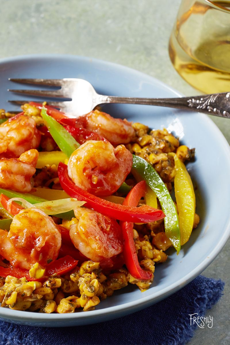 Our Shrimp Fajita is a fiesta for your fork! This traditional meal brings the heat with fresh shrimp over Mexican street corn, roasted bell peppers, and zesty chipotle salsa.