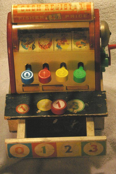 Fisher Price Cash Register from 1960. This was the first cash register made by Fisher Price. It's mostly wood, with some plastic used for clear covers & the bell crank. Includes one wooden coin.