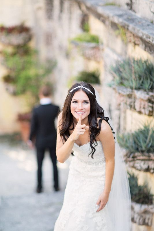 Cute and unique wedding First Look photo idea of the bride and
