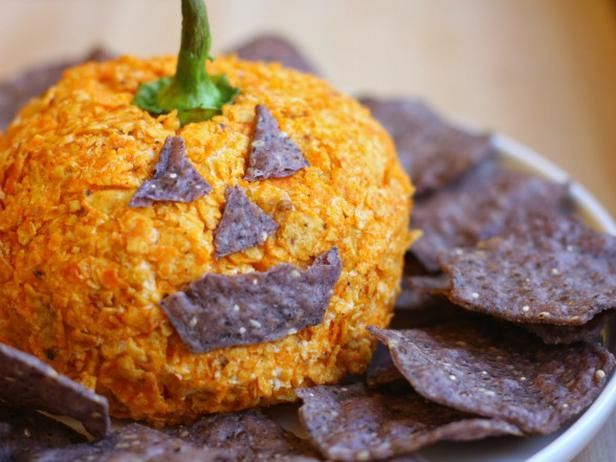 Nacho Jack-o'-Lantern Cheese Ball -- This nacho-flavored, pumpkin-shaped cheese ball is just the thing for your Halloween party. It looks like a pumpkin, but tastes like everyone's favorite party chip.