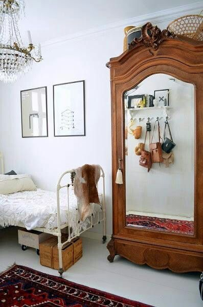 Kids Room, Patterned Rug, White Walls, Mirrored Armoire And Hooks