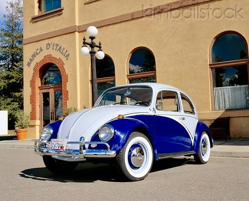 Aut 22 Rk1689 02 1967 Vw Beetle Two Tone Blue Low 3 4 Front View On Pavement By Building Vw Beetles Volkswagen Beetle Vw Bug