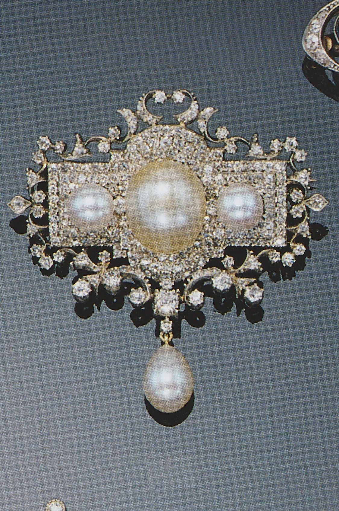 A Belle Epoque pearl and diamond brooch, circa 1900. Of cartouche design, set with circular-cut diamonds and decorated with three pearls, supporting a pear-shaped pearl drop. Source: Sotheby's, Art Nouveau Jewellery and Jewels from the Belle Epoque 1890-1914, London, 18 June, 1998. #BelleÉpoque #brooch