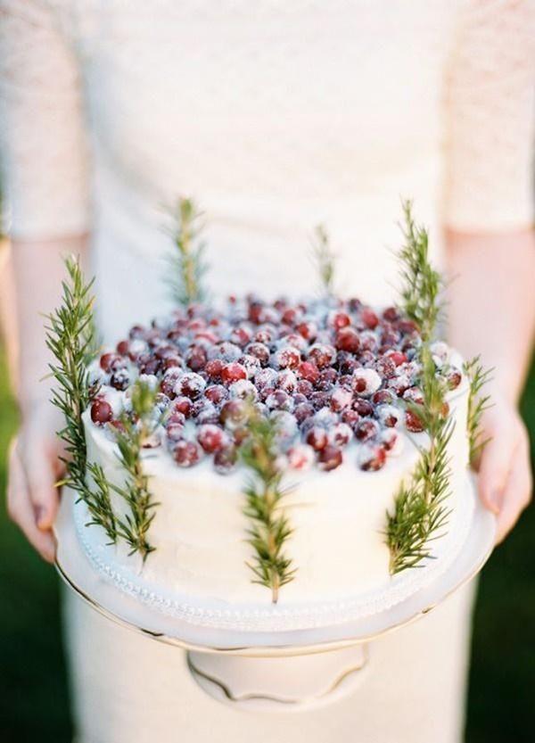 Cranberry and rosemary sprigs on an all white wedding cake @myweddingdotcom