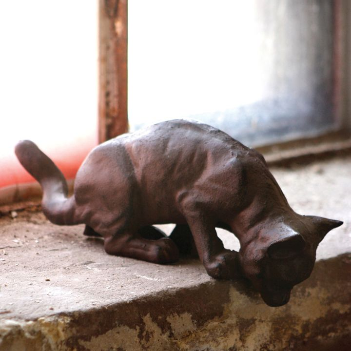 """Our Rustic Cast Iron Pouncing Cat stalks his prey from your mantel shelf. Lifelike features with a long tail and lean figure.brbrliDimensions: 11""""w x 4""""hlibrbrThese unique, hand-crafted a..."""