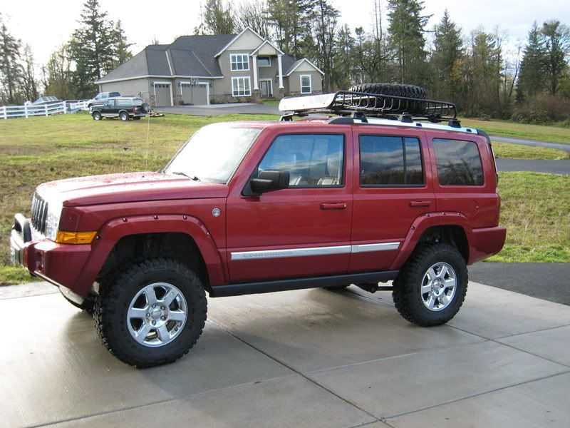 "lifted jeep commander Re AEV 4"" lift, tires, roof"