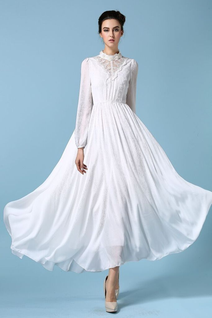 White long sleeve flowing dress.